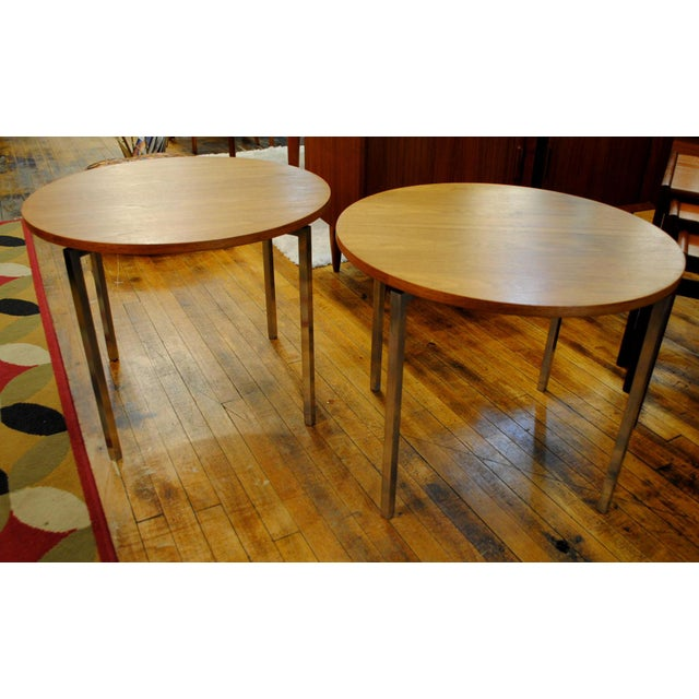 Elegant Pair of Round Side Tables designed by Florence Knoll in the 1960's. Solid Walnut Tops each with four legs. Legs...