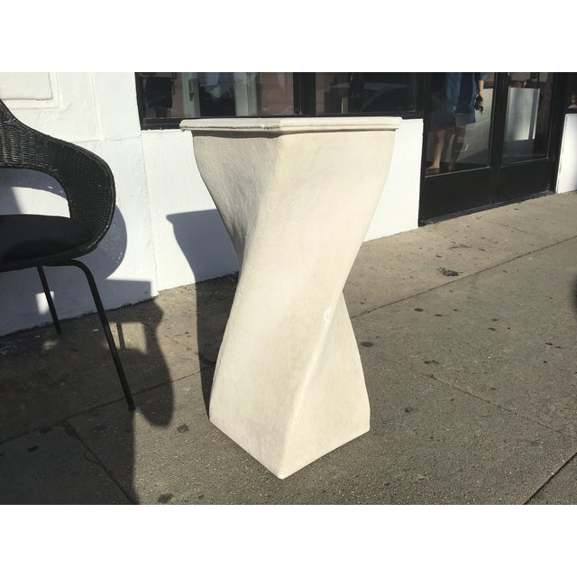 Textured Plaster pedestal made in the 80s in a unique twisted shape. Great for a minimal or Mediterranean look. Works...