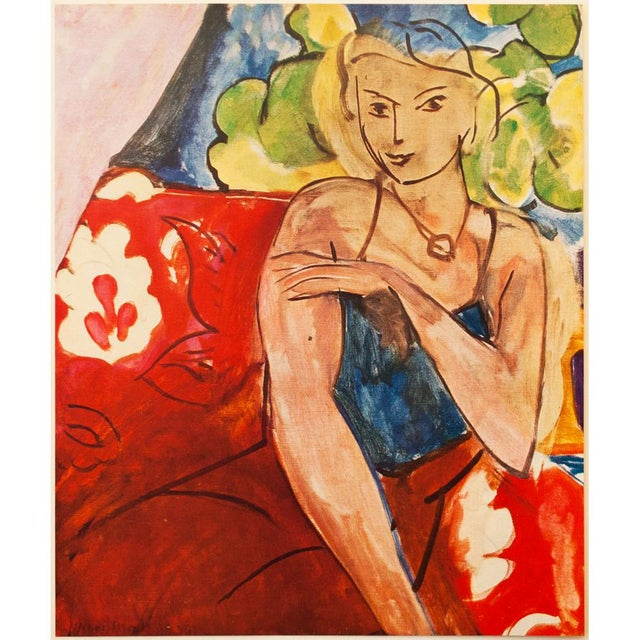 """A gorgeous original period tipped-in lithograph after painting """"Girl on a Red Background"""" (1936) by Henri Matisse. Signed..."""