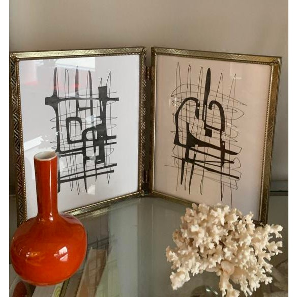 Two original drawings framed in vintage metal frames. This unique frame is compromised of two frames joined together that...