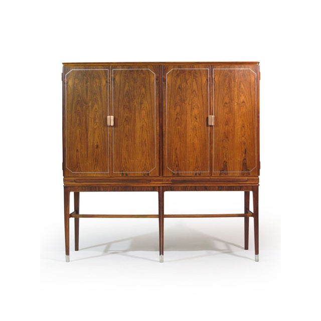 Handcrafted Brazilian Rosewood sideboard by master cabinetmaker Georg Kofoed. Brazilian Rosewood with book-matched doors...