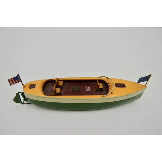Vintage metal wind up boat with original paint made by Ivas, C.1960. Windup key is missing.