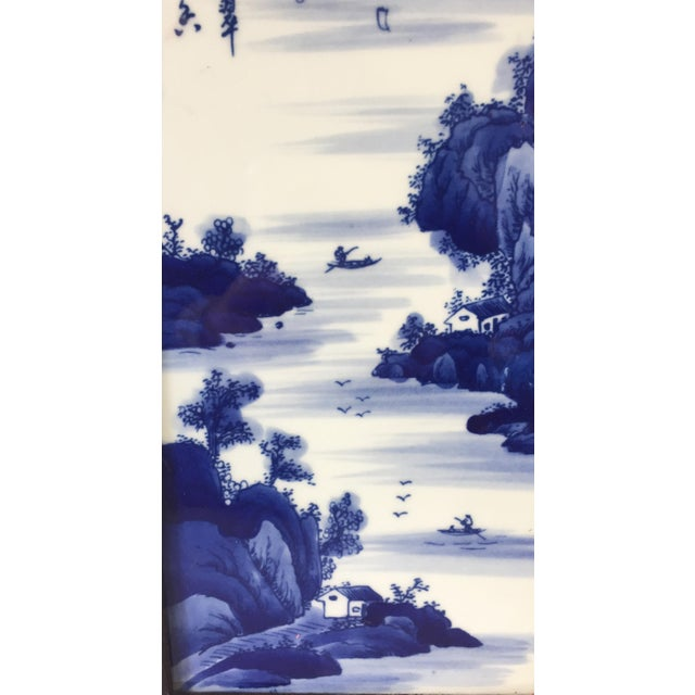 Superb Chinese blue and white porcelain panel depicting an amazing landscape with mountains figures houses etc... Framed...