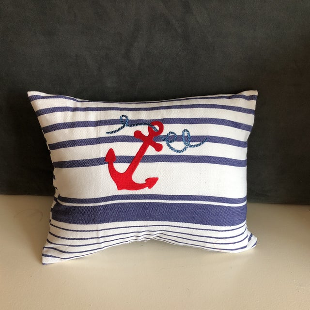 Nautical white and blue stripe With embroidered design Perfect for your beach house. Poly filling and zipper closure.