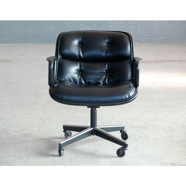 Charles Pollock's timeless leather upholstered swivel Executive chair designed in 1965. This chair produced around 1970...