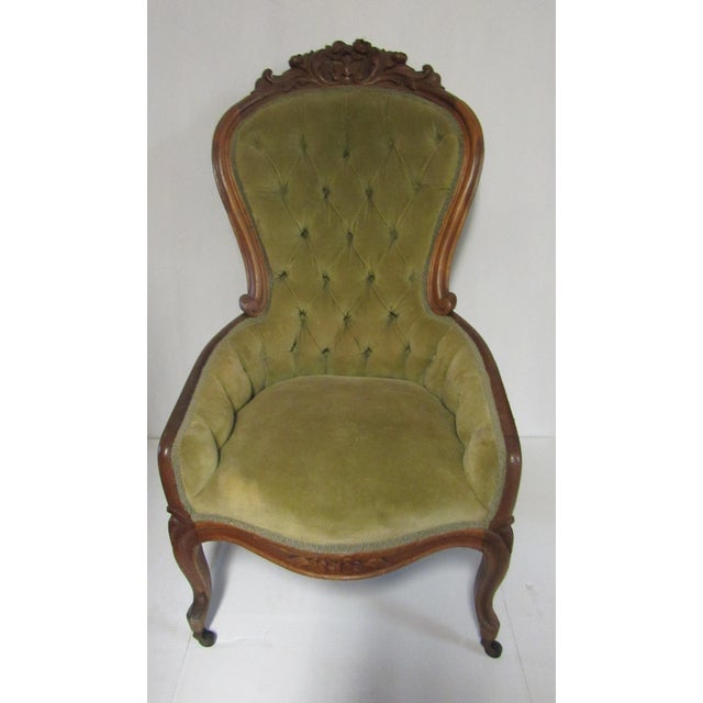 Beautiful antique Victorian slip or boudoir chair, green velvet upholstery and cherry wood frame with hard carved detail,...