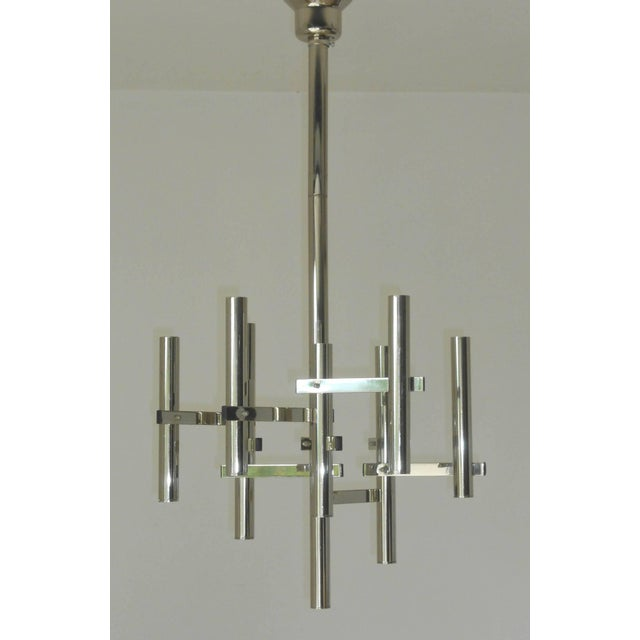 Original vintage chandelier with geometrical nine chrome arms and frame, by Sciolari. Made in Italy in the 1960s 9 lights...