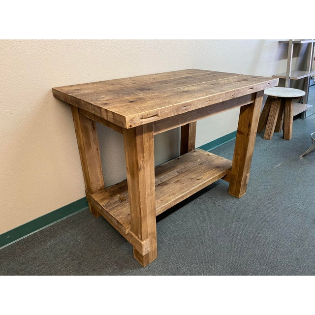 Design Plus Gallery presents a Salvaged Wood Island by Restoration Hardware. A farmhouse style table referencing Parsons...