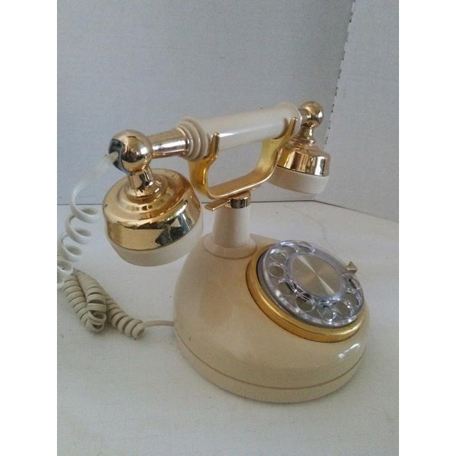 1970s French style princess telephone. telephone works well. shows signs of normal use with small scratches on the phone...