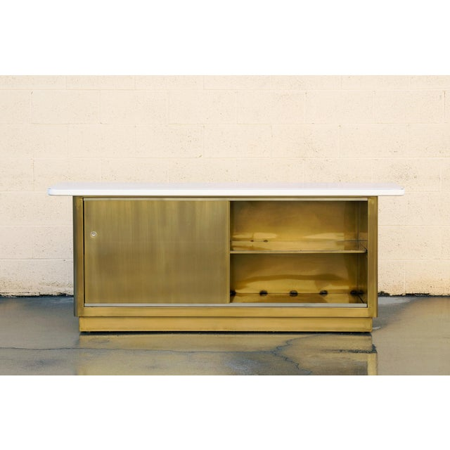 Custom made steel credenza inspired by tanker style furniture popular in the 1960s. This beauty features a two-tone brass...
