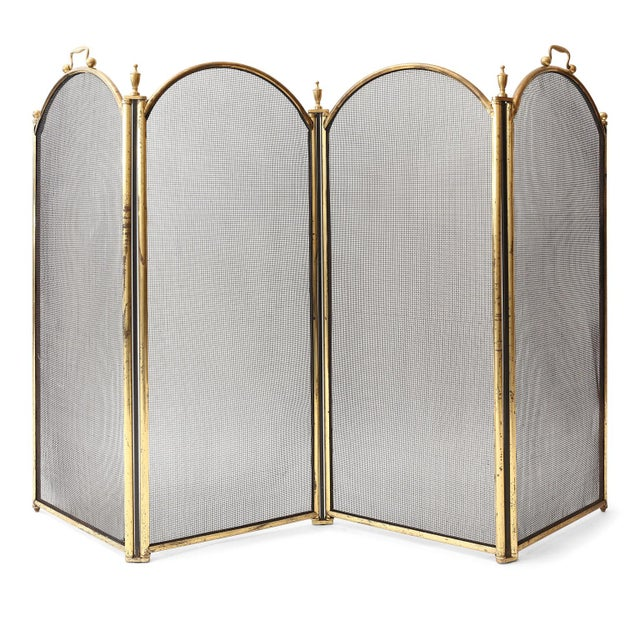 Unusually tall, heavy fire screen: four mesh panels framed in a hinged heavy brass border. Adorned with both decorative...
