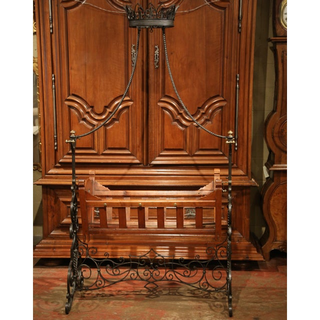 This beautiful, antique crib on a stand was crafted in Paris, France circa 1870. The classic, fruit wood infant bed...