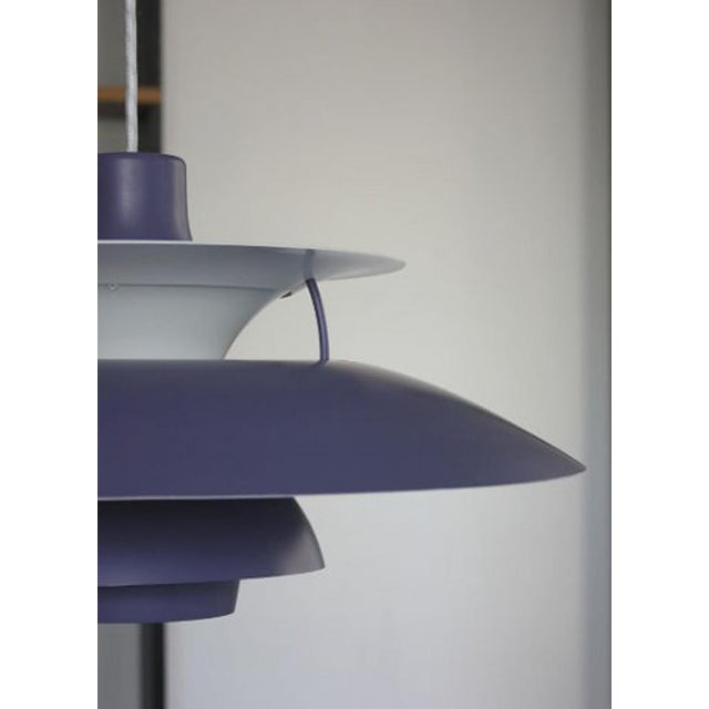 The PH5 pendant was designed by Poul Henningsen for Louis Poulsen in 1958. The lampshade is lavender-colored with a white...