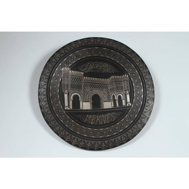 Handcrafted in Morocco, hanging blackened round metal tray, hand chased with the doors of the city of Meknes. Black...