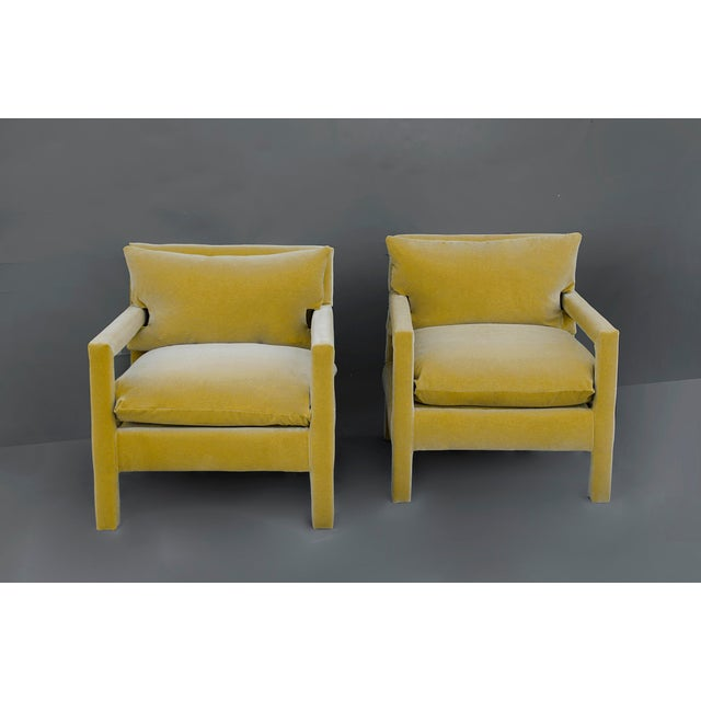 Exceptional pair of 1970's Parson Style Lounge Chairs after Milo Baughman, newly upholstered in a 100% cotton Yellow...