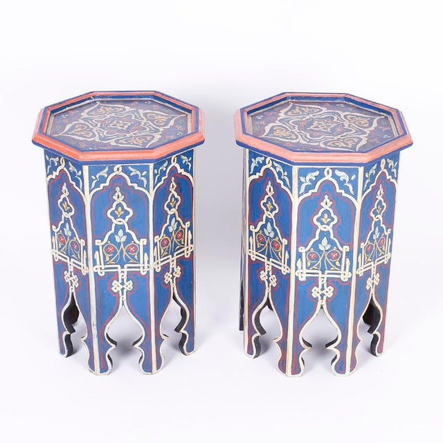Intriguing pair of antique Moroccan wood stands with an octagon form painted with distinctive mediterranean colors in...