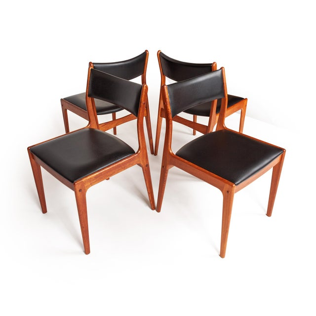 A exquisite set of four sold teak dining chairs by Johannes Anderson for Uldum Møbelfabrik, made in Denmark in the 1960's....