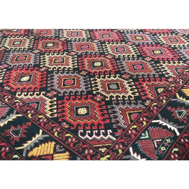 This elegantly handwoven rug is from Pakistan. It is crafted from the finest wool to create a soft and luxurious piece...