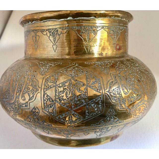 Brass Middle Eastern Persian Islamic bowl finely and heavily hand-etched and hand carved with Arabic calligraphy writing...