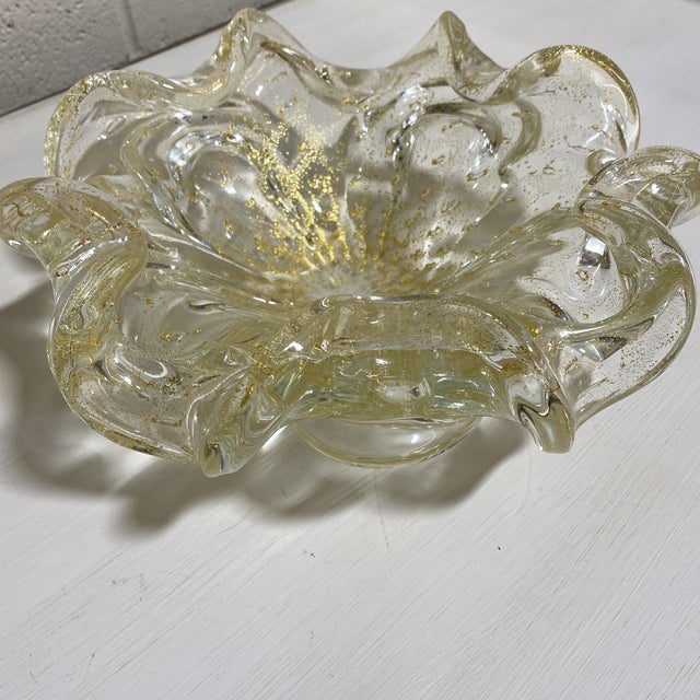 Large vintage Murano glass decorative bowl from Italy. Hefty, thick glass with gold leaf flecks throughout. No chips,...