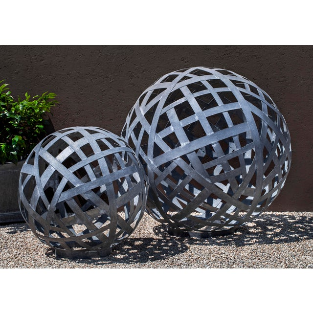A spherical garden ornament composed of strips of Zinc coated Steel. Also available in a larger size.