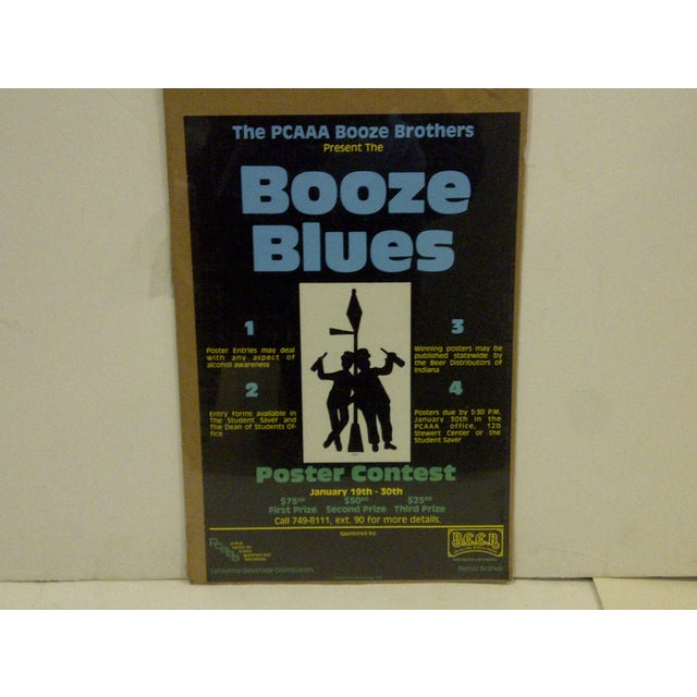 """A vintage concert poster for """"Booze Blues"""" from a poster contest, January 19th-30th, 1980. Copyright 1980–Designology. The..."""