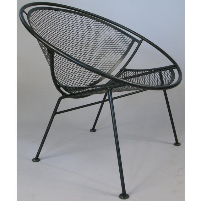 A matched pair of 1950s wrought iron 'Radar' collection lounge chairs designed by Maurizio Tempestini for Salterini....