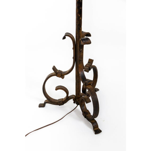 A beautiful, French, hand wrought, iron floor lamp with Renaissance Revival influences; textural, hammered accents, and...