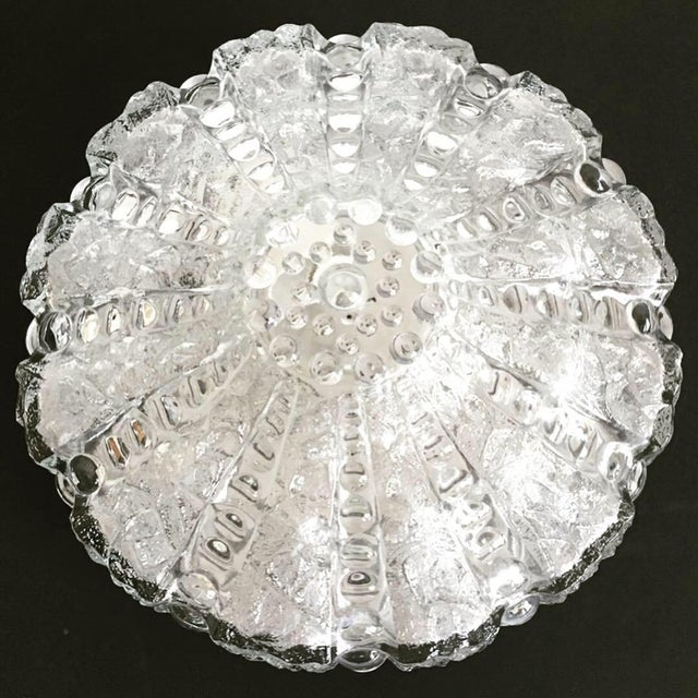 Stunning mid-century ice glass flush mount light by Erco Leuchten featuring a round pudding-style shade with alternating...