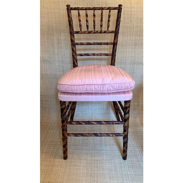 Elegant antique faux tortoise painted bamboo ballroom chairs. Scalamandre Pink Strie silk seats with down filled cushions....