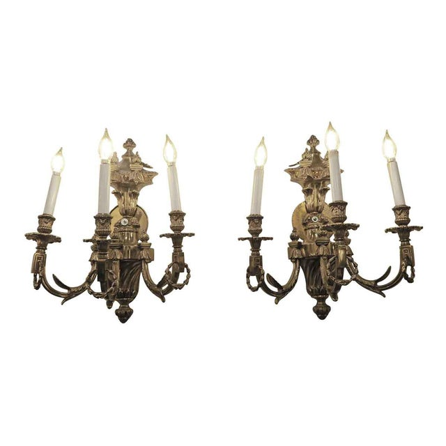 Heavy cast bronze triple arm sconces from Conrad Suite Foyer in the Waldorf Astoria Hotel. Priced each. Waldorf Astoria...