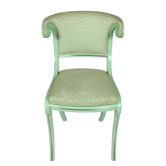 A set of six aqua lacquered klismos style dining chairs with twist details to back. Upholstered seats and back