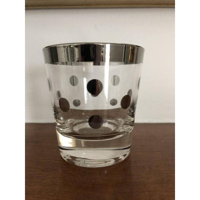 A set of six low ball vintage drinking glasses by Dorothy Thorpe in a fun silver rimmed and polka dot pattern.
