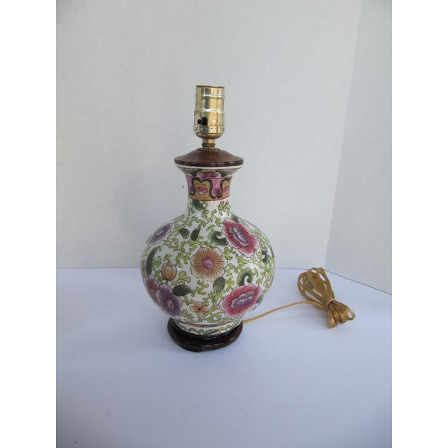 Gorgeous and colorful Chinoiserie table lamp made of vintage vase with green, purple and pink flowers and leaves.