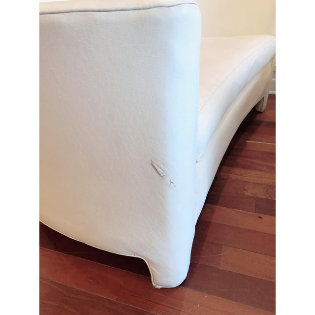 Sleek pair of 1960s love seats from Sherrill. These white vinyl love seats sit low, feature upholstered legs and a lovely...