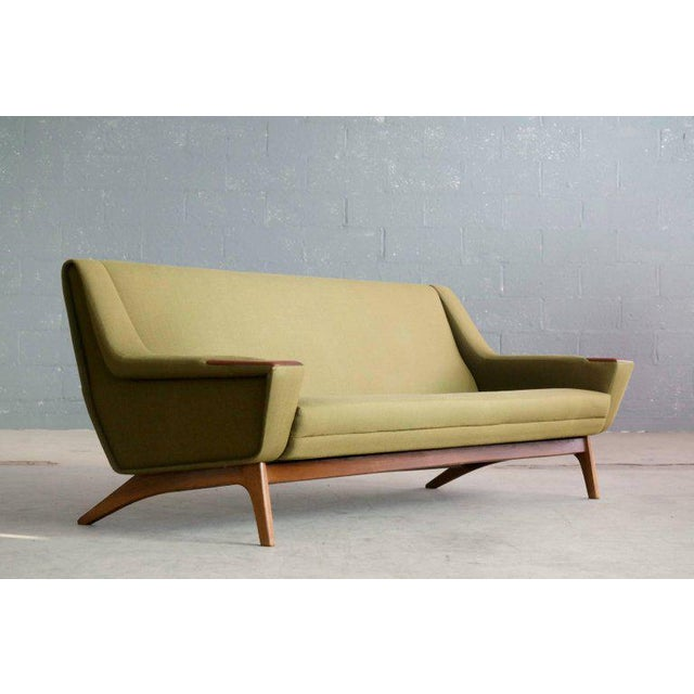 Very elegant and stylish 1960s sofa in the style of Illum Wikkelsø and Leif Hansen for Erhardsen and Erlandsen. Raised on...