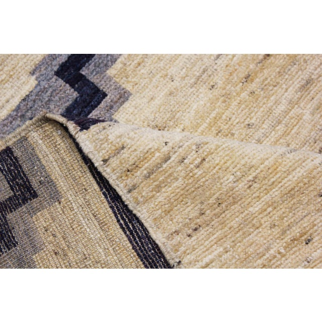 It is a beautiful Navajo Design handmade rug from Afghanistan with organic colors .