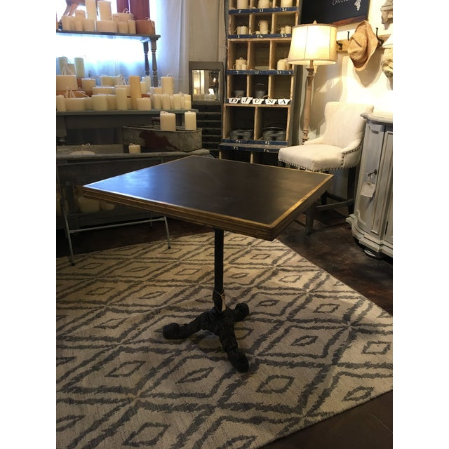 This beautiful table was Vintage inspired from cafe table from France. Crafted with cast iron base and brass plated edged,...