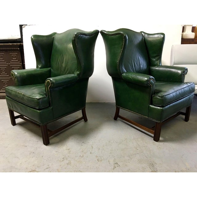 Here is an extraordinary pair of vintage leather oversize wingback chairs by Ethan Allen done in lovely emerald green...