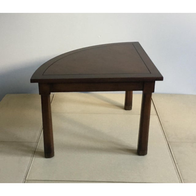 Unusual corner table in dark walnut finish. Resembling a giant player piece for Trivial Pursuit, this quarter circle...