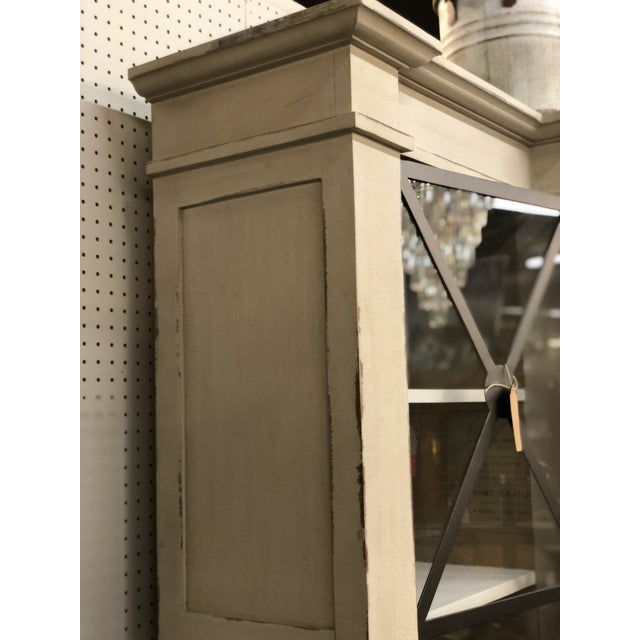 This stunning painted and distressed French Neoclassical style three door China cabinet exudes class and elegance. With...