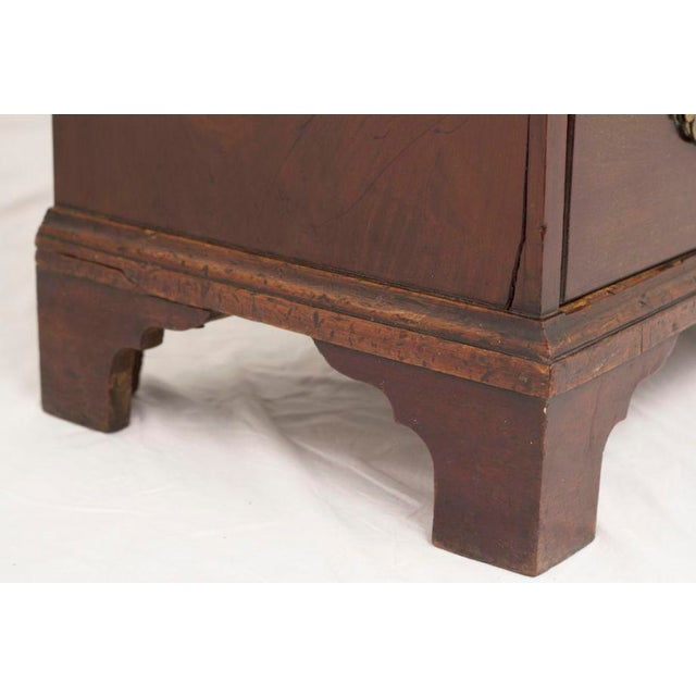 A hard to find small scaled English Chippendale mahogany chest made early in the 19th century.