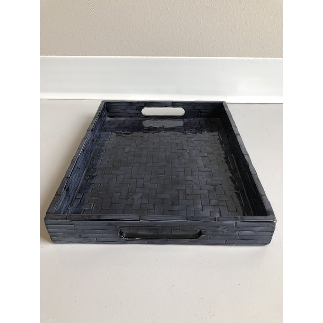 This Tozai Home is a small midnight blue, mother of pearl, criss cross, lacquered tray.