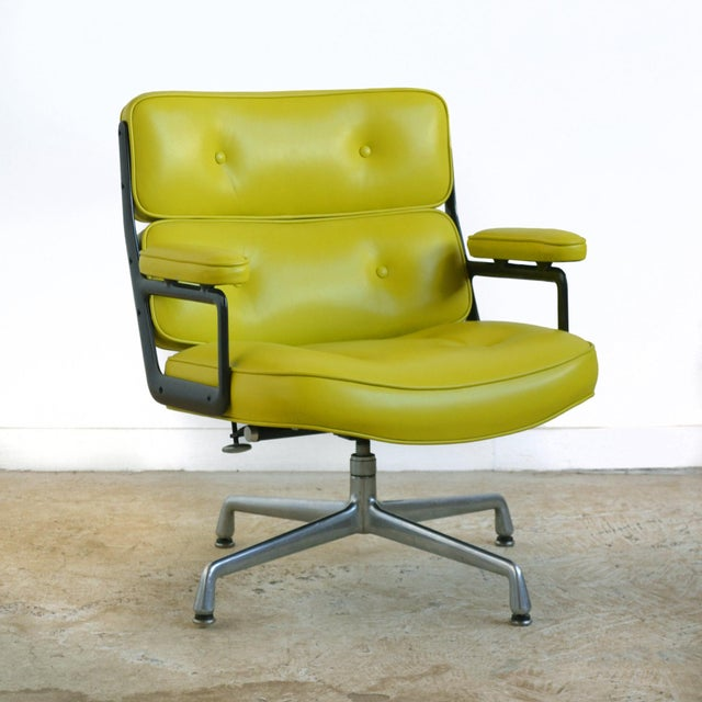 This Classic time-life chair by Charles and Ray Eames has been given a makeover with wonderful vivid green leather...