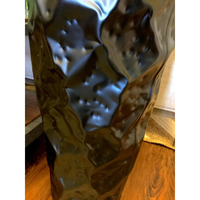 Medium size tall hammered metal planter with a black matte finish. Indoor use, liner recommended for live plants. Great...