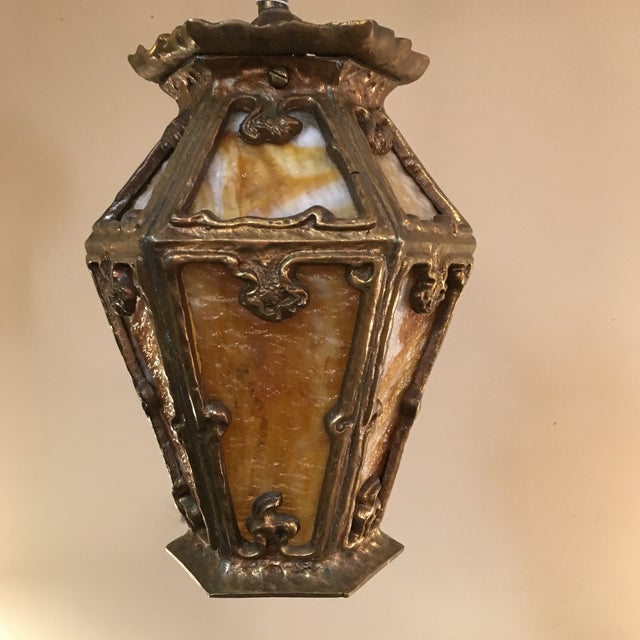Arts and crafts period, cast iron pendant, circa 1915. This light has been rewired with ceramic socket, and can be hung on...