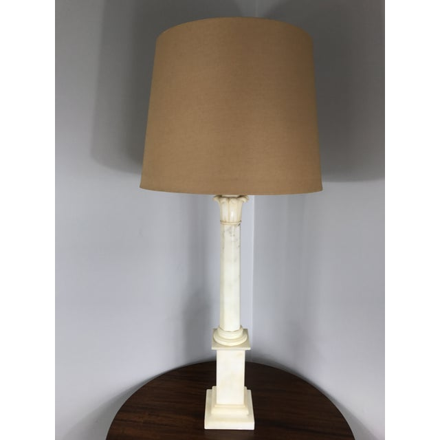 A tall Hollywood Regency alabaster column lamp. Shade for display purposes only.