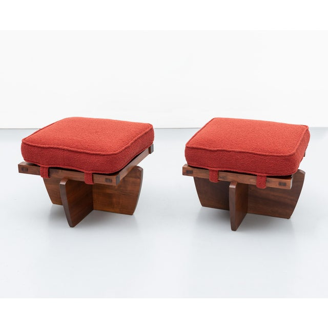 A rare pair of walnut Greenrock stools by George Nakashima in walnut with rosewood mortise and tenon joints. New cushions...
