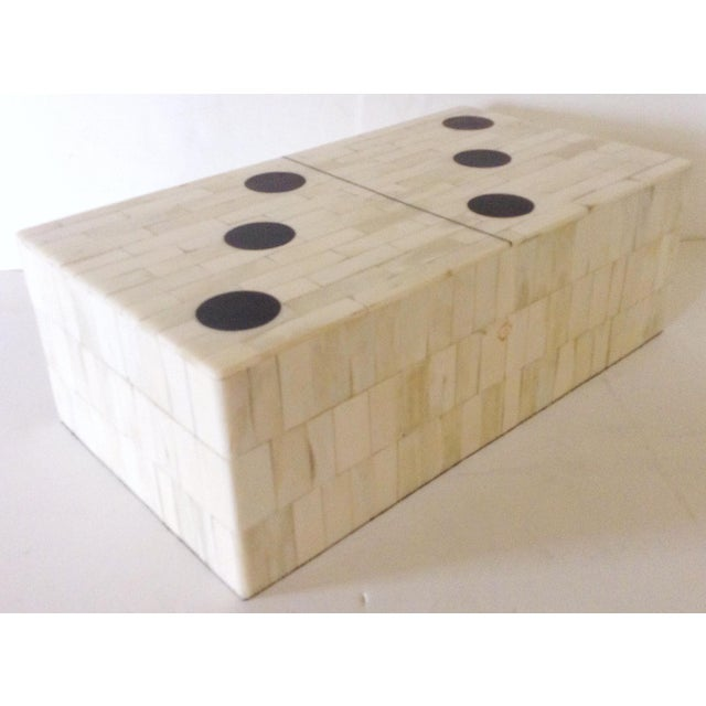 Fun box in the shape and style of a domino piece is veneered on the outside with bone and fitted inside with wood for a...