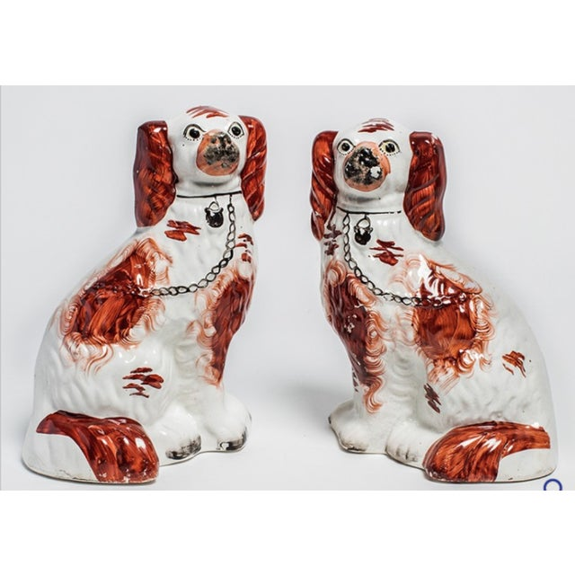 Pair of ruby Staffordshire dogs.